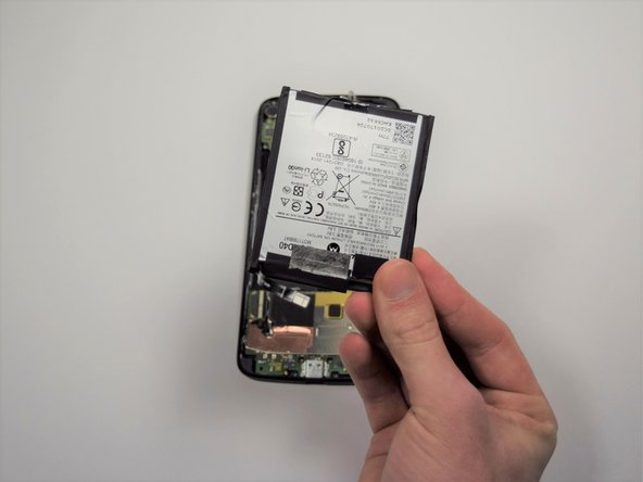 After you have removed the motherboard, only the battery should remain on the device's body.