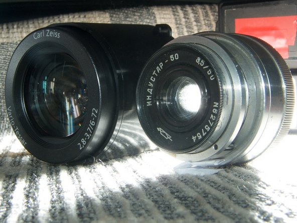 The Carl Zeiss lens from the sony camera alongside the lens from a Zorki-6 soviet compact rangefinder from 1960.