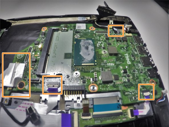 Image 2/2: Remove the tape wires from the system board.