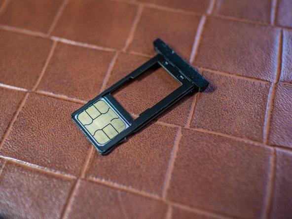 Remove the SIM/SD tray.