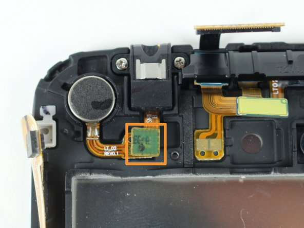 After removing the screws, carefully lift the headphone jack connector with the tweezers.