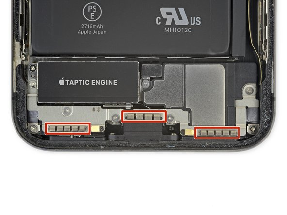 Be careful not to touch the three rows of grounding pads near the bottom of the iPhone.