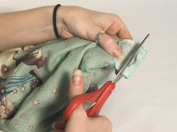Make sure to remove the pin before sewing and back stitch at the beginning and end so the stitches don't unravel.