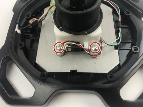 Remove the four 10mm Phillips #1 screws from the joystick base.