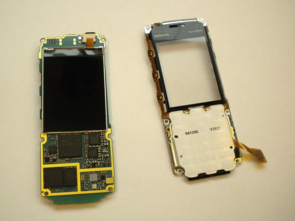 At this point the phone should come apart into 2 pieces, the motherboard/LCD screen and the faceplate