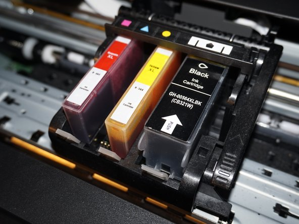 Image 3/3: Once the old ink cartridge(s) have been removed, open your new ink cartridge(s) and install the replacement ink cartridge. Push down by the locking tab to ensure the ink cartridge is securely installed.