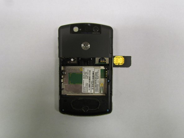 Remove the existing SIM card (if applicable) by applying little pressure with one finger and dragging it until the card is completely out.