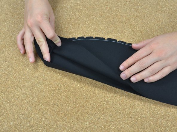 Once you have cut triangles all along the seam, turn the fabric inside out so that the seam is now on the inside.