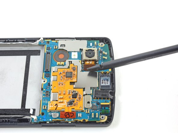 Use the flat end of a spudger to disconnect the ribbon cable that connects rear-facing camera to the motherboard.
