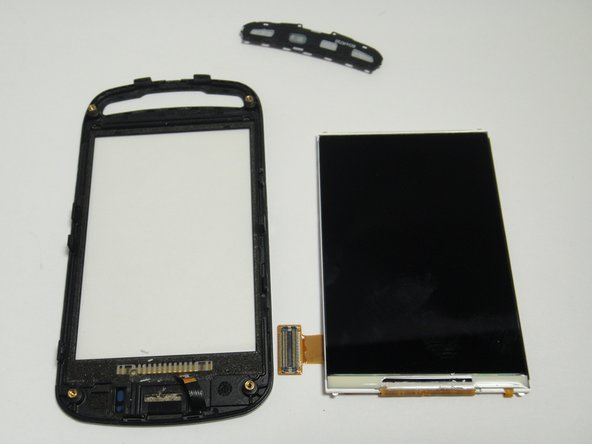 Insert new screen into the phone frame and reconnect the ribbon cable.