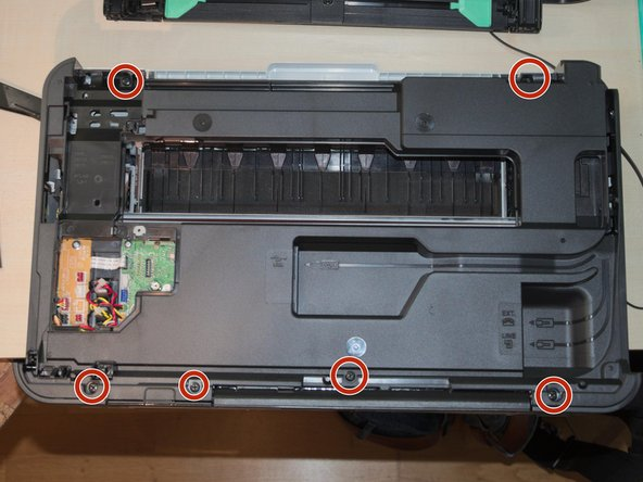 Remove the screws connecting the black plastic cover to the printer (see image)