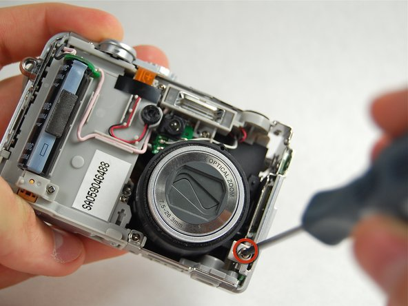 Remove the screw connecting the wifi card cover to the front of the camera.