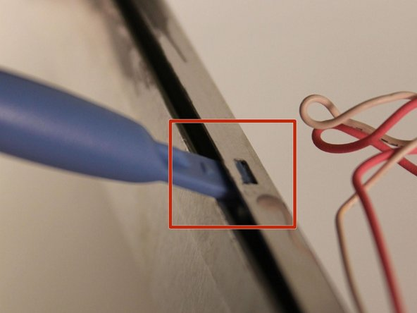 Image 1/3: Once all of the latches are unhooked, genitally pull the metal case up to expose the CCFL tube.