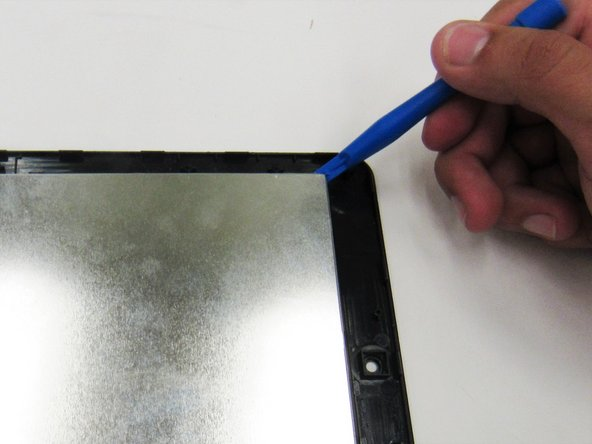 Make sure the display ribbons are not tucked underneath the LCD display when reassembling the screen and LCD display (as shown in the first image of this step).