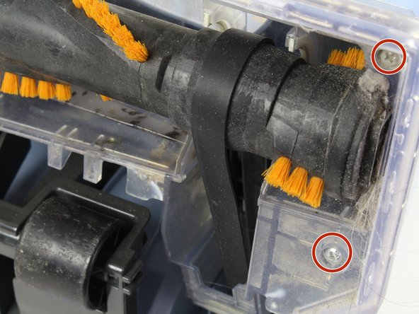 Use a Phillips #1 screwdriver to remove the two screws on the right side of the brush.