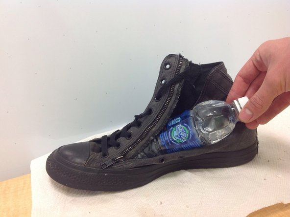 Stuff a 2/3 full water bottle into the shoe.