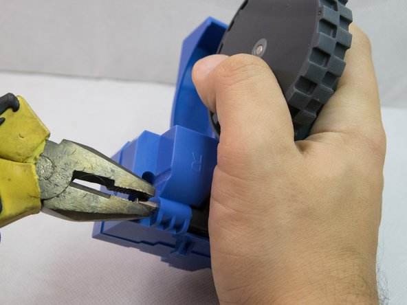 Use pliers to pull from the other end to remove the pin completely