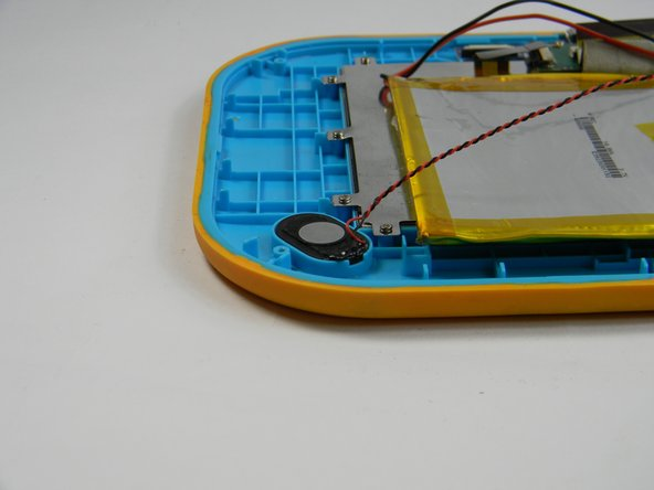 Using the plastic opening tool, gently pry the speaker out of its plastic housing.