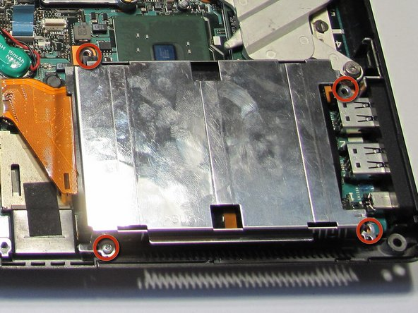 Locate the screws holding the hard drive casing in place.