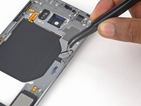 Use tweezers to remove the power button.