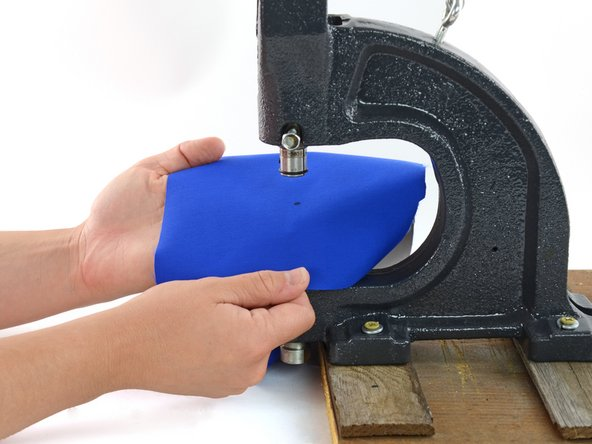 Image 2/2: Align the fabric in the hand press so that the mark rests directly above the shaft of the post.