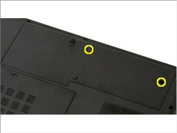 Remove the two screws that secure the hard drive and mini-card access panel to the computer.