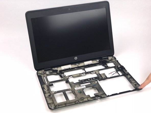 The display is connected to the shell of the laptop.