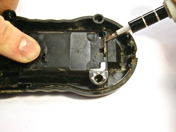 Once the circuit board is removed from the back plate of the radio, the battery terminals can be removed.