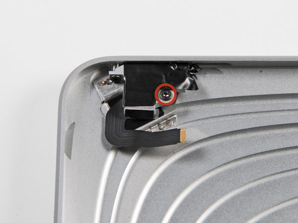 Image 1/2: Remove a couple screws and pull the headphone jack out of the rear case.