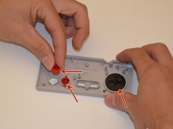 Remove all plastic buttons. Clean the buttons and controller with soap and water.