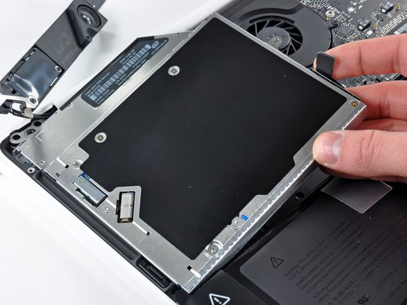 To identify the optical drive, look for a large square component that has a slot or bay for a disc to be inserted into.