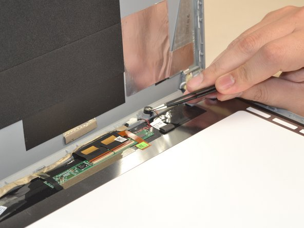Remove the microphone from the motherboard with a pair of blunt nose tweezers.