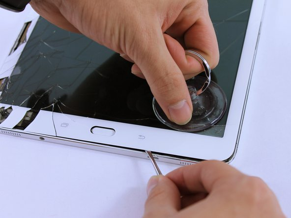 When prying open near the home and touch screen buttons, use a suction cup.