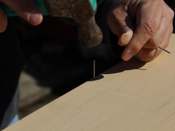 Start from the top and work your way down each side when putting the nails in so the board doesn't bow.