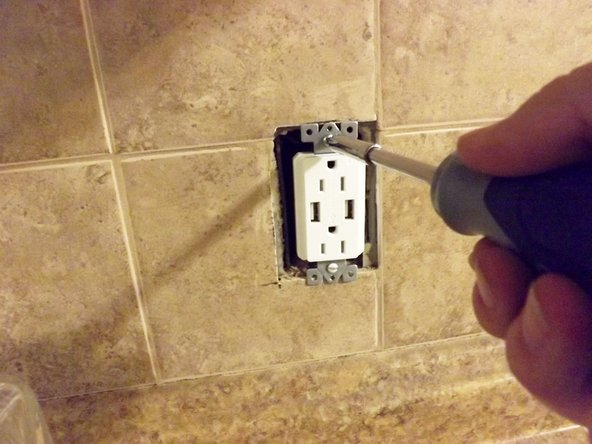 Reassemble the outlet as it was removed.