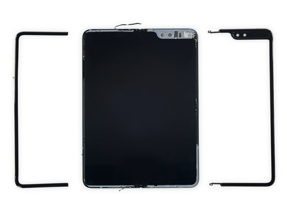 Now bezel-less, the screen is primed for prying off! We didn't need any heat last time, but today it seems Samsung isn't taking chances—they want this screen to stay put, and have added an extra sticky strip of black tar goop.