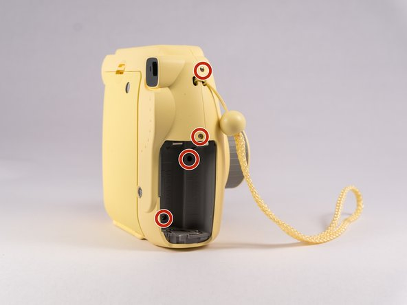 Remove screws from bottom of camera with a small #00 Phillips Screwdriver. Then remove screws around the camera. Additionally, there are two screws in the battery compartment which also need to be removed