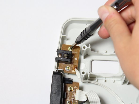 Lift the Ethernet connector to remove it from the case.