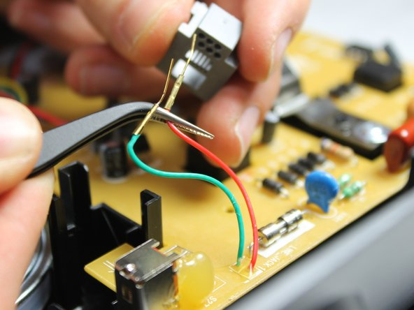 After bending the golden wire tips, pull the wires out from the back side of the phone jack.