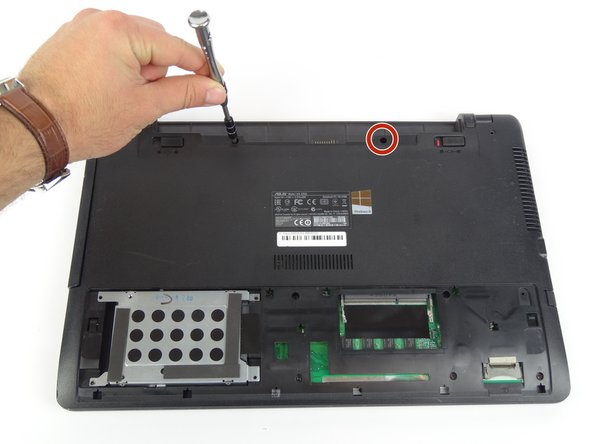 Use Tri-wing Y1 screwdriver to remove two 12mm screws from battery area.