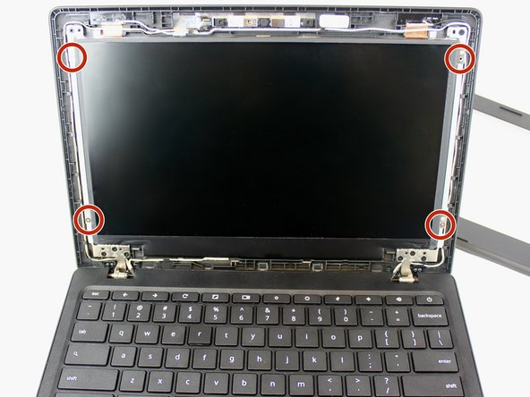 Use the #0 Phillips screwdriver to remove the four 6mm screws from the screen.