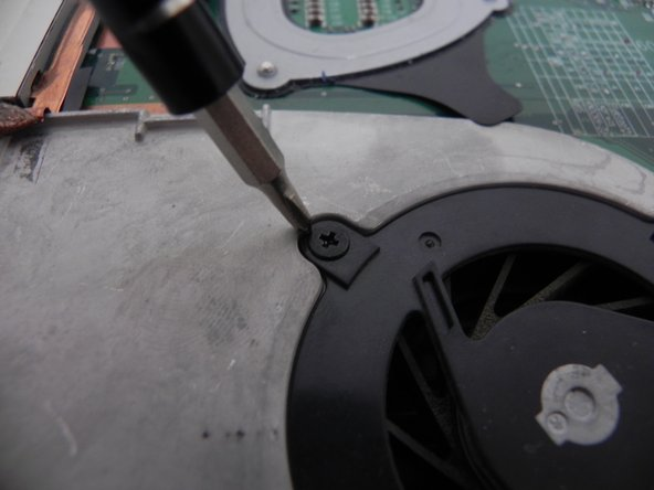 Unscrew the fan unit from the motherboard using a #0 screwdriver. Once the fan is unscrewed and unplugged from the motherboard, it can be replaced.