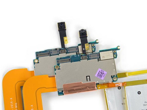 Image 1/1: Our preliminary look at the logic board reveals a small and expected change: the lack of a rear camera connector.