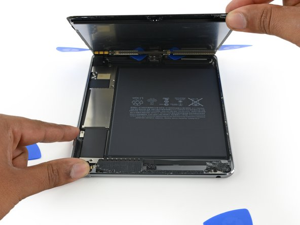 Image 3/3: Lift the display from the top edge to open the device.