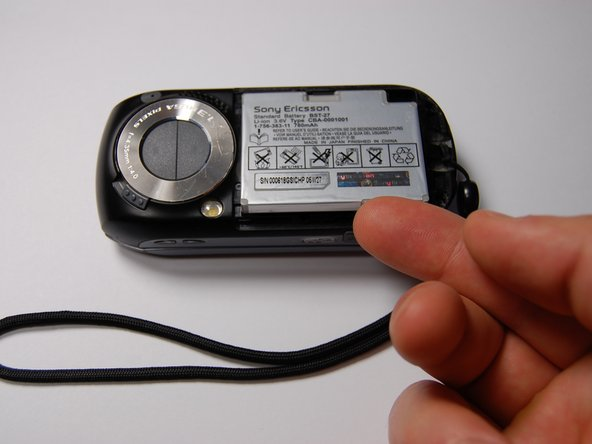 Once the back cover is removed, pull out the battery using your finger as shown.