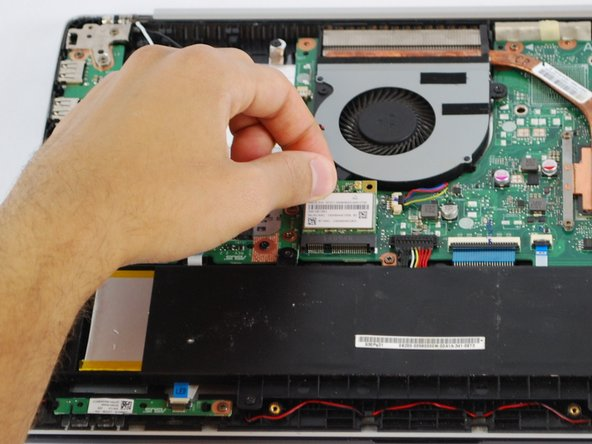 Unplug the Wi-Fi card from the motherboard and remove it from the device.
