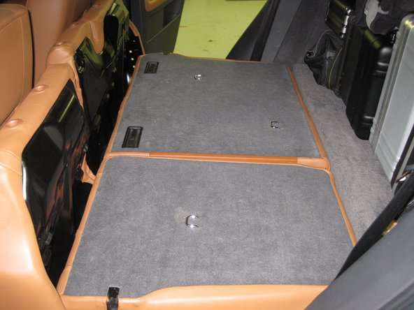 Image 3/3: Flip the bottom of the seats forward.  Remove the headrests, and lay the seat-backs down flat.