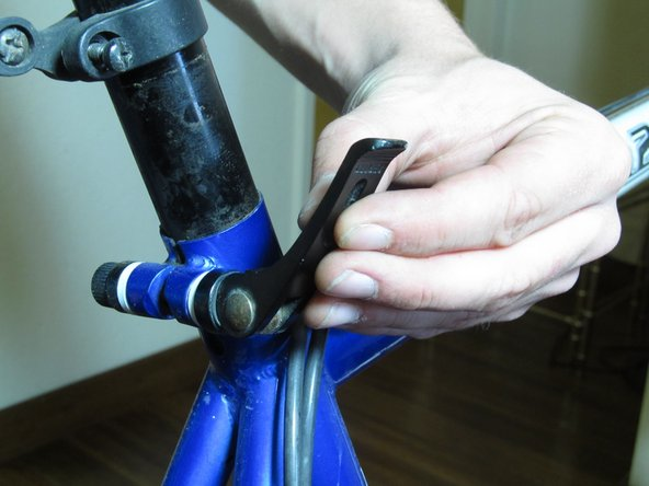 Image 2/3: Stand on the right side of the bike while loosening the lever, be sure the bike isn't upside-down.