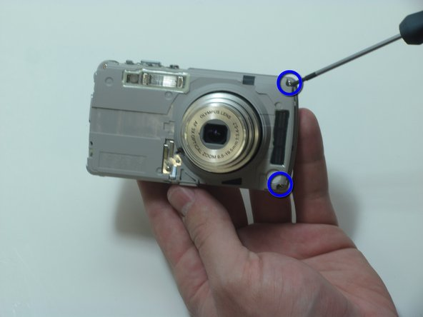 Image 1/3: Remove the 2 screwson the left side of the camera