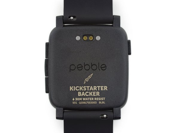 The back of the smartwatch is adorned with several markings, along with the port for the charging dock.